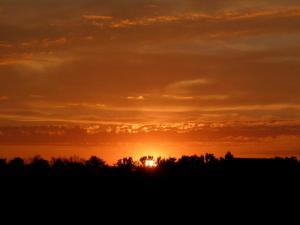 Sun rising over a straight ridge
