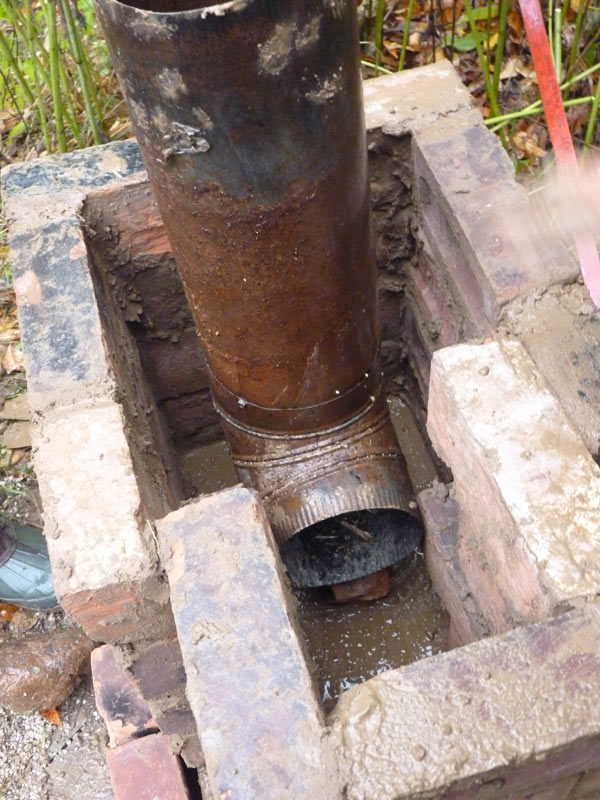 Brick and cob rocket stove the druid 39 s garden for How to make a rocket stove with bricks