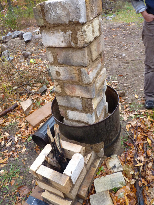 Brick and cob rocket stove the druid 39 s garden for Brick jet stove