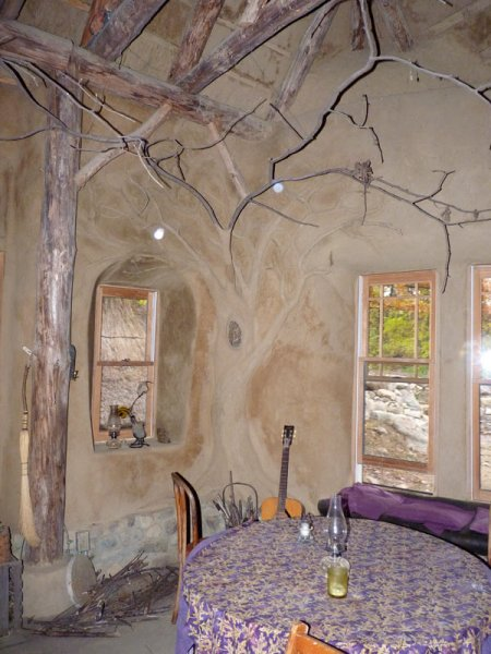 The inside of Strawbale studio with curves and beautiful features