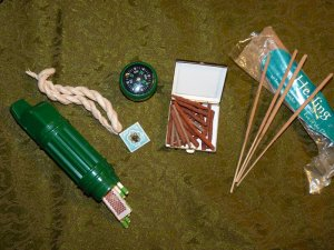 Incense, matches, a whistle/waterproof match holder and compass