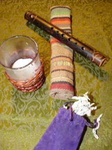 Flute with pouch; white sage; candle holder