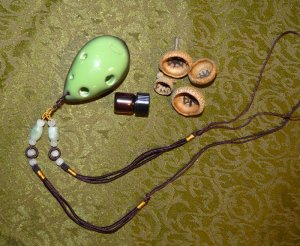 Ocarina necklace, oil vial, and acorn caps