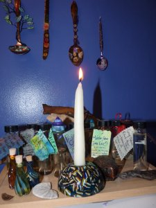Candle burning on shrine