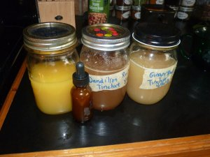 Completed strained bitters, and smaller bottle for mixing.