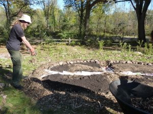 Adding more mulch as the bed takes shape!