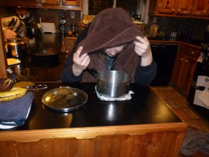 Carefully put your head over the pot with the towel