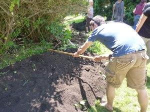 Ryan smooths the pile