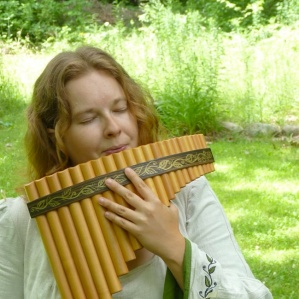 Playing the panflute for the land