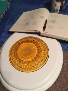 Starting sketches and using a plate to trace my outer image