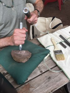 Carving stones with ogham at our stonecarving workshop at MAGUS