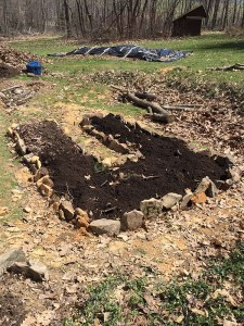 Adding finished compost to the bed