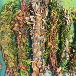 Smudge sticks with various components--center one has a sweetgrass braid!