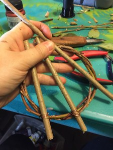 Cutting branches for an awen symbol