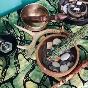 A simple indoor altar with singing bowl