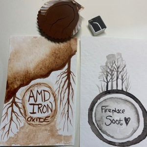 Two finished paints: soot from my fireplace and iron from a local Acid Mine Drainage remediation site